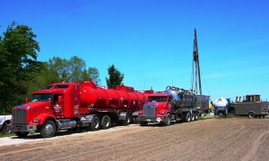 Fiberglass trailer for high volume hydrochloric acid transport and high pressure pumping truck.