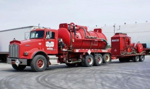 High pressure pumping truck with vacuum capabilities with hot-oiler trailer.