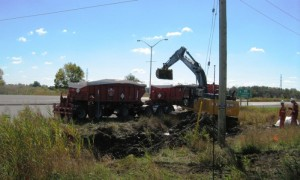 Btrains being loaded with fuel contaminated soil along 401 Highway.