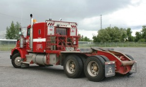 Winch truck for mobilization of frac tanks, mobile trailers, and drilling equipment.