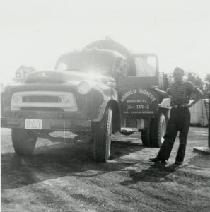 Employee, James Coleman, standing with 1959 I.H.C. truck. (1959)