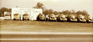 Harold standing with his truck line-up. (1960)