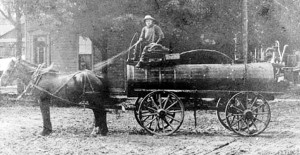 Harold's father, Andy, hauling oil by horse and wagon into Bothwell.