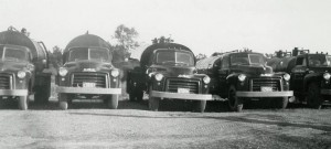 Harold's truck line-up. Ranging from a 33 barrel to 60 barrel tanks. (Est. 1953)