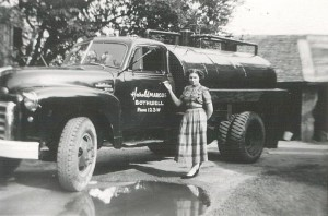 Harold's wife, Vera, pictured with a new oil truck.
