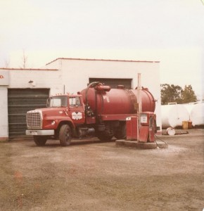 Small vacuum truck in front of Harold Marcus Limited. (Est. 1980's)