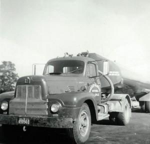 1955 I.H.C. tractor and 1955 Fruehauf 132 barrel trailer. (September 1955)